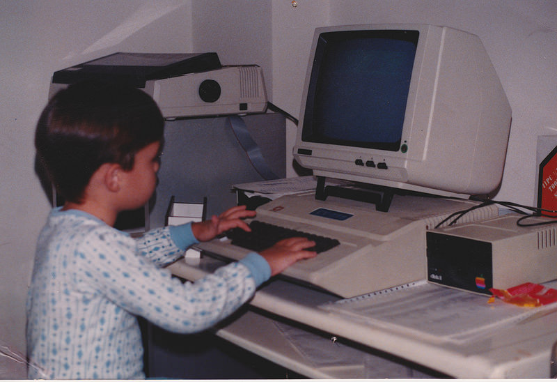 me, playing with an Apple II